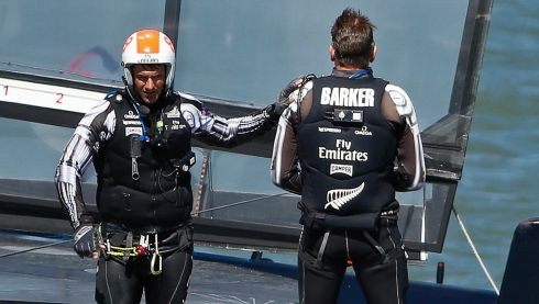Emirates Team New Zealand's Jeremy Lomas (left) pats skipper Dean Barker on the shoulder after losing Race 17 of the 34th America's Cup.  Photograph: Stephen Lam/Reuters