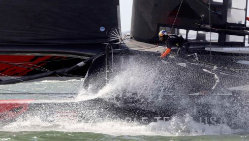 A burst of spray hits Team USA during Race 14. Photograph: Robert Galbraith/Reuters