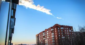 A meteorite trail is seen above a residential apartment block in the Urals city of Chelyabinsk, on February 15th. A heavy meteor shower rained down on central Russia, sowing panic as the hurtling space debris smashed windows and injured dozens of stunned locals. Photograph: Oleg Kargopolov/AFP/Getty Images