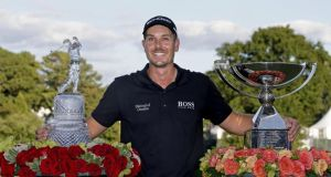 Sweden's Henrik Stenson with the trophies after winning the Tour Championship and FedEx Cup at East Lake Golf Club, in Atlanta. Photograph: AP Photo