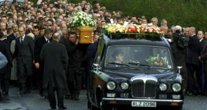 Crowds attend the funeral of  Sunday World journalist Martin O'Hagan in 2001. Photograph: Bryan O'Brien/The Irish Times