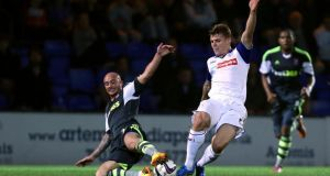 Tranmere Rovers' Max Power (centre) and Stoke City's Stephen Ireland during the League Cup, third round match at Prenton Park, Tranmere. Photograph: Peter Byrne/PA Wire