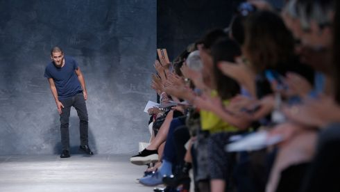 Portuguese designer Felipe Oliveira Baptista appears at the end of his Spring/Summer 2014 women's ready-to-wear fashion show.    Photograph: Gonzalo Fuentes/Reuters
