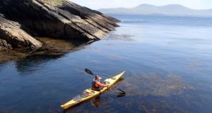 Gary Quinn paddling around Puffin Island with the Kerry mainland in the distance. Photograph: David Quinn