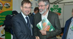 Fianna Fail TD Éamon Ó Cuív and Sinn Féin president and TD Gerry Adams on the final day of the National Ploughing Championships in Co Laois yesterday. Photograph: Barbara Lindberg.