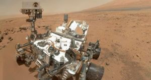Nasa's Curiosity rover used the Mars Hand Lens Imager  to capture this set of 55 high-resolution images, which were stitched together to create this full-colour self-portrait. Photograph: JPL-Caltech/Malin Space Science Systems/Nasa/Reuters