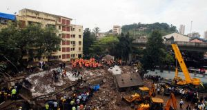 Rescue crews search for survivors at the site of a collapsed residential building in Mumbai, India. Photograph: Danish Siddiqui/Reuters