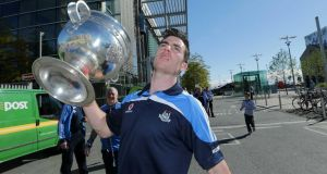 Michael Darragh Macauley holding the  the Sam Maguire cup. Photograph: Morgan Treacy/Inpho