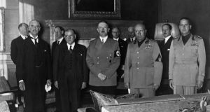 "'This is the Führerbau, from which Neville Chamberlain emerged on September 30th 1938, to return to England waving a scrap of white paper, bearing the signature of Hitler and declaring ""Peace in our time"".' Above, left to right: Lord Neville Chamberlain, Edouard Daladier, Adolf Hitler, Benito Mussolini  and Count Gian Galeazzo Ciano  gathered on September 29th, 1938  to sign the Munich treaty.  Photograph: AFP/Getty Images"