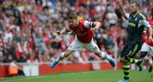 Arsenal will give a fitness test to midfielder Aaron Ramsey before their match at Swansea