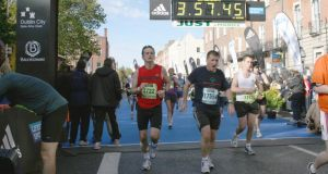 Matt English (centre) completing the 2010 Dublin City Marathon in under four hours