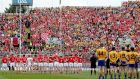Clare and Cork stand to attention before the national anthem prior to the start of the drawn All-Ireland final earlier this month. Photo: James Crombie/Inpho