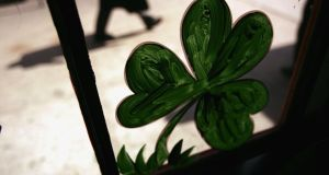 A shamrock is viewed in the window of an Irish pub in preparation for St Patrick's Day celebrations in New York City. Some 150 publicans, representing 600 Irish pubs worldwide, will attend the Irish Pubs Global Gathering Event in the Burlington Hotel from Sunday evening.  Photograph: Spencer Platt/Getty Images