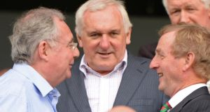 Former Taoiseach Bertie Ahern chats with Taoiseach Enda Kenny and Minister for Communications Pat Rabbitte during the All Ireland senior football championship semi-final between Mayo and Tyrone at Croke Park in August. Photograph: Dara Mac Dónaill/The Irish Times