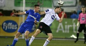 Dundalk's Brian Gartland with Craig Curran of Limerick at Oriel Park last night. Photograph: Morgan Treacy/Inpho