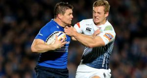 Leinster's Brian O'Driscoll and Owen Williams of Cardiff Blues in action at the RDS. Photograph: James Crombie/Inpho