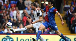 Swansea City's Michu (left) battles for possession with Crystal Palace's Mile Jedinak. Photograph: PA