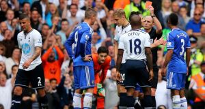 Chelsea striker Fernando Torres  is shown the red card by referee Mike Dean during the  Premier League match against  Tottenham Hotspur  at White Hart Lane. Photo by Clive Rose/Getty Images