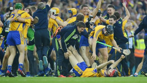 Clare players celebrate victory over Cork with team mates. Photograph: Alan Betson/Irish Times
