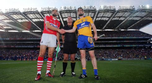 Referee James McGrath with captains Patrick Donnellan and Patrick Cronin. Photograph: INPHO/Donall Farmer