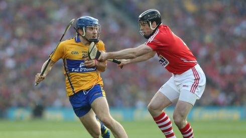 Clares triple-goal scorer Shane O'Donnell and Cork's Shane O'Neill. Photograph: Alan Betson/Irish Times