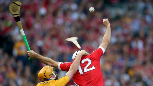 Clare's Cian Dillon and Patrick Cronin of Cork. Photograph: INPHO/Ryan Byrne