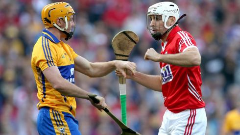 Clare's Cian Dillon and Patrick Cronin of Cork clash off the ball. Photograph: INPHO/Ryan Byrne