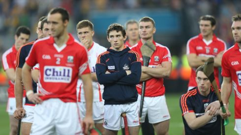 Disappointed Cork players stand after the final whistle. Photograph: Alan Betson/Irish Times
