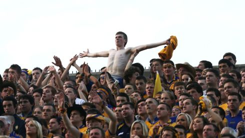 Clare fans go wild celebrating  after the final whistle  at Croke Park. Photograph: Alan Betson/Irish Times