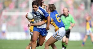 Cavan's Roisin O'Keeffe is tackled by  Claire Carroll of Tipperary during the ladies' intermediate All-Ireland final at Croke Park. Photograph: Ryan Byrne/Inpho.