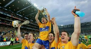 Clare players celebrate with hat-trick goalscorer Shane O'Donnell who hoists the Liam MacCarthy Cup aloft at Croke Park on Saturday. Phogograph: Morgan Treacy/Inpho