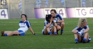 Monaghan's Cathriona McConnell, Therese McNally, Grainne McNally and Ciara McAnespie after loosing by a point to Cork in the All-Ireland  women's football final at Croke Park.  Photograph: Alan Betson