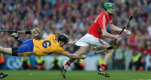 Seamus Harnedy of Cork is fouled by Clare's Patrick Donnellan of Clare in Saturday's final. Photograph: Donall Farmer/Inpho