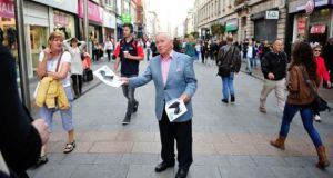 Senator Fergal Quinn of Democracy Matters in Dublin's Henry Street on Saturday campaigning for a No vote in the Seanad referendum. Photograph: Aidan Crawley