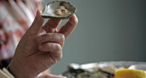 """The rules are that you have 30 oysters that you have to open as fast as possible,"" explains festival commercial manager Suzanne Meade. ""But it's not just about time, its about presentation as well: you have to be careful not to cut the meat of the oyster, you have to be careful not to break the shell."" Photograph: Eric Luke/The Irish Times"