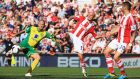 Anthony Pilkington of Norwich City is closed down by Stephen Ireland of Stoke City during the  Premier League match at Britannia Stadium. Photograph: Richard Heathcote/Getty Images