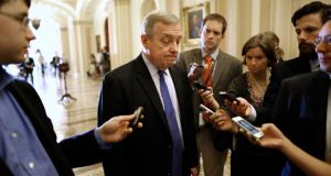 US Senate Majority Whip Dick Durbin (D-IL) talks to reporters as he walks to a Senate Democratic caucus meeting at the US Capitol in Washington. The Obama administration has accelerated its push to persuade individual Americans to sign up for the most extensive overhaul of the US healthcare system in 50 years, as the program's foes in Congress fight to delay its launch with the threat of a federal government shutdown. Photograph: Jonathan Ernst/Reuters