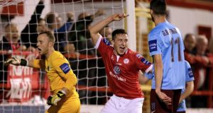 Shelbourne's Robert Cornwall celebrates after Derek Doyle scored the opening goal against Drogheda United.  Photograph: James Crombie/Inpho