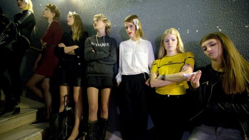 Models wait for the start of a rehearsal during Paris Fashion Week today. Photograph: Reuters
