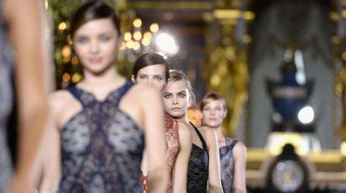 Miranda Kerr (L), Cara Delevingne (C) and models walk the runway during Stella McCartney  at Paris Fashion Week yesterday. Photograph: Pascal Le Segretain/Getty Images