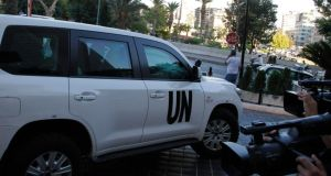 A UN vehicle transporting a team of United Nations experts charged with starting the process of verifying and eliminating chemical weapons arrives at a hotel in Damascus yesterday. Photograph: Reuters.