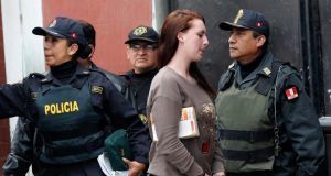 Michaella McCollum Connolly  is escorted from a truck to court at Sarita Colonia prison in Callao yesterday. Photograph: Mariana Bazo/Reuters