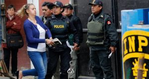 Melissa Reid  is escorted from a truck to court at Sarita Colonia prison in Callao, yesterday. Photograph: Mariana Bazo/Reuters