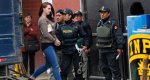Michaella McCollum Connolly is escorted from a truck to court at Sarita Colonia prison in Callao. Photograph: Mariana Bazo/Reuters