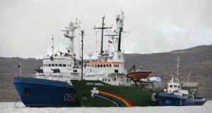 The Greenpeace ship Arctic Sunrise is seen anchored outside the Arctic port city of Murmansk, on the day when members of a Russian Investigation Committee conducted an inspection of it. Photograph: Dmitri Sharomov/Greenpeace/Reuters