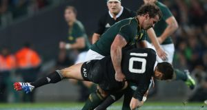 Bismarck Du Plessis of South Africa tackles Dan Carter of the All Blacks at Eden Park on September 14th. Du Plessis received a yellow card for the tackle. Photograph: Sandra Mu/Getty Images