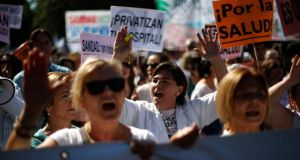 Healthcare workers and supporters take part in a protest against the local government's plans to cut public healthcare spending in Madrid last month. Photograph:  Reuters