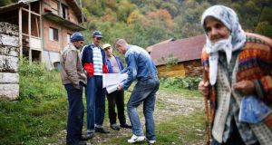 Bosnian Muslims speak with a surveyor in Krusev Do as part of Bosnia's first postwar census. Photograph: Reuters