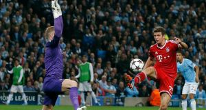 Bayern Munich's Thomas Muller goes past Manchester City's Joe Hart to score during their Champions League match at the Etihad Stadium. Photograph: Reuters