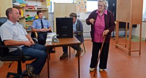 Presiding officer Páraic Ó Conghaíle, garda Paul Quinn and poll clerk Páraic Donoghue look on as Kathleen Conneely casts her vote on Inis Oírr. Photograph: Eric Luke